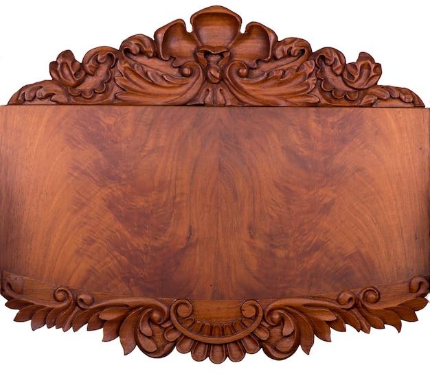 Motif sculpté sur bois, élément de décor.