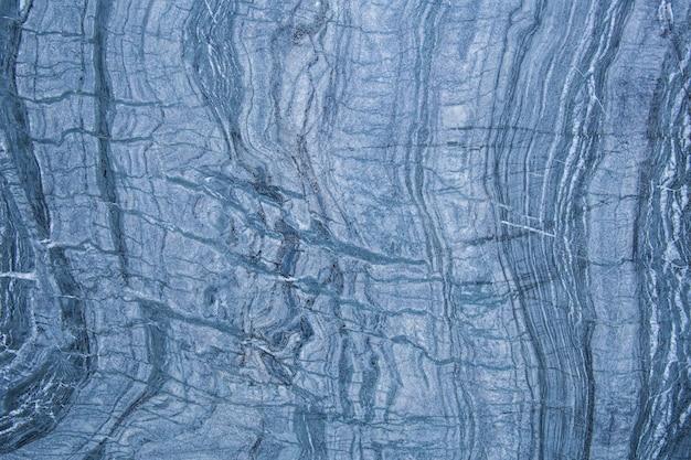 Le motif et la surface des murs de marbre bleu, blanc et noir pour le fond.