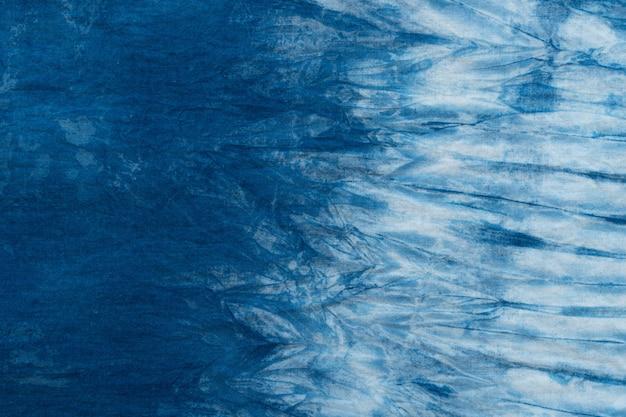Motif de teinture batik cravate bleue sur toile de coton