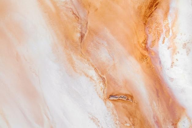 Motif de texture de marbre abstrait. fond de texture de marbre. beaux motifs orange vus d'en haut