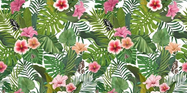 Motif tropical sans couture avec des fleurs et des feuilles d'hibiscus