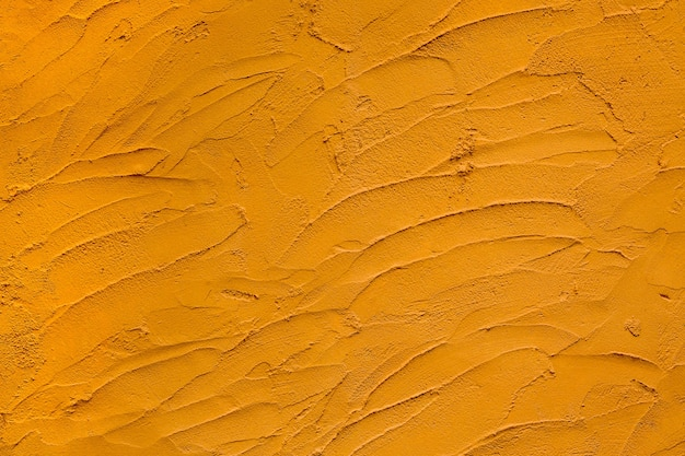 Motifs colorés et surfaces de fond de ciment jaune.
