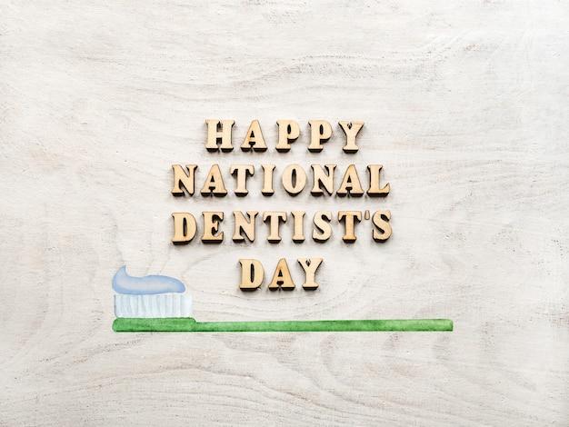 Mots de jour du dentiste avec brosse à dents sur table en bois