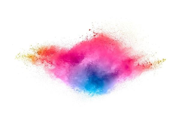 Mouvement flou abstrait de particules de poussière colorées sur fond noir.