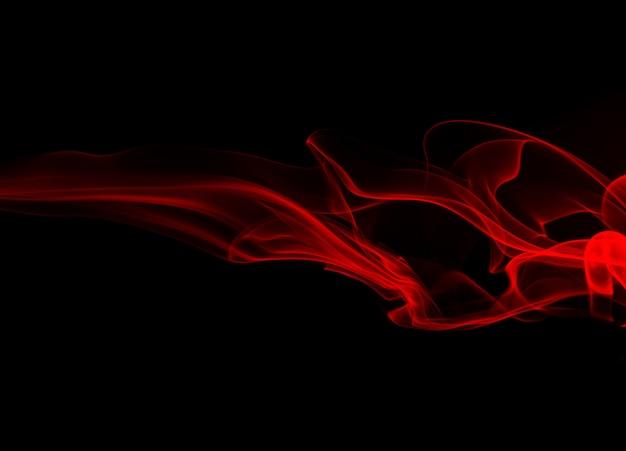 Mouvement de résumé de fumée rouge sur fond noir