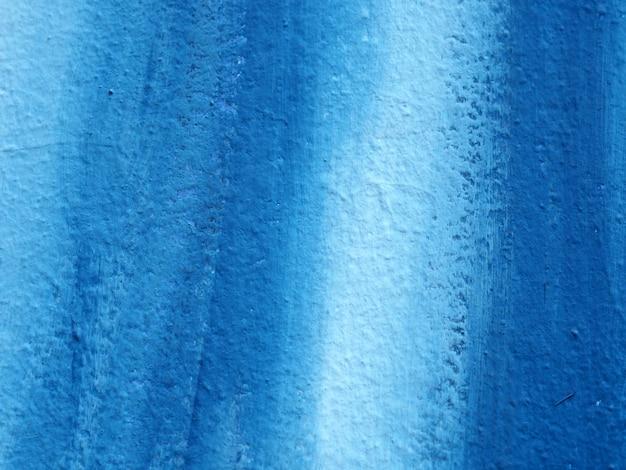 Mur abstrait de peinture bleue.