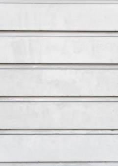 Mur d'acier blanc abstrait