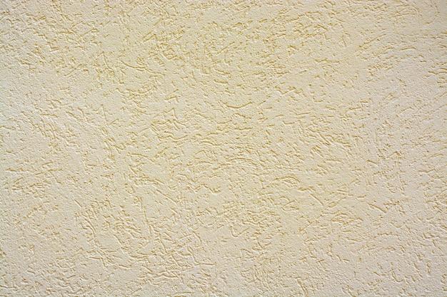 Mur de béton en arrière-plan, traces d'altération, le mur usé a endommagé la peinture, vieille peinture.