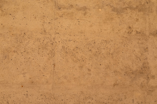 Mur de béton beige-brun, texture intérieure