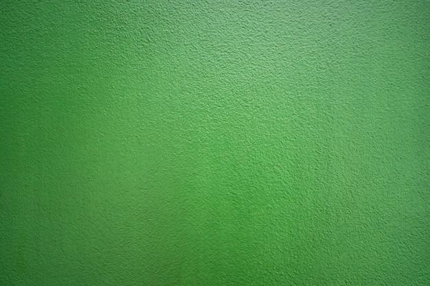 Mur de béton de ciment de couleur verte pour fond de texture.