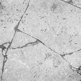 Mur de béton fissuré. texture vieux fond grunge. surface en béton avec fissure