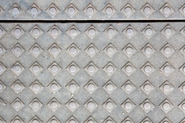 Mur en béton avec des formes carrées