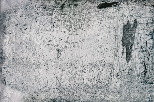 Le mur de béton gris, bleu et blanc avec motif et lignes en relief en plâtre