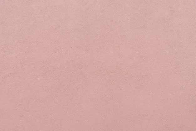 Mur de béton rose abstrait