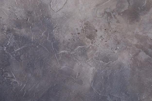 Mur de béton, texture grise, dessin abstrait
