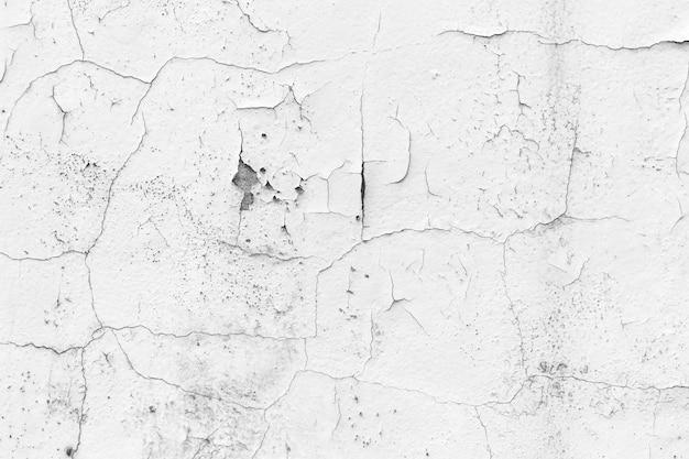Mur blanc avec fond de fissures