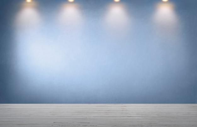 Mur bleu avec une rangée de projecteurs dans une pièce vide