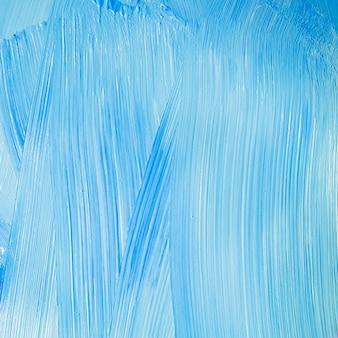 Mur bleu avec texture de coups de pinceau
