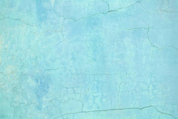 Mur bleu, texture de fond de rue de ciment coloré