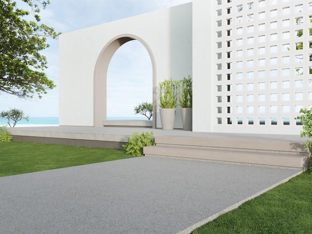 Mur de blocs de ventilation blanc et passerelle en béton vide avec vue sur la mer