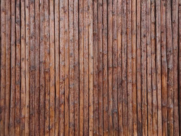 Mur en bois d'une clôture ou d'une maison, texture en bois de rondins