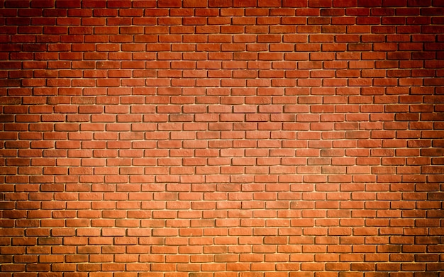 Mur de brique de bloc brun rouge magnifiquement