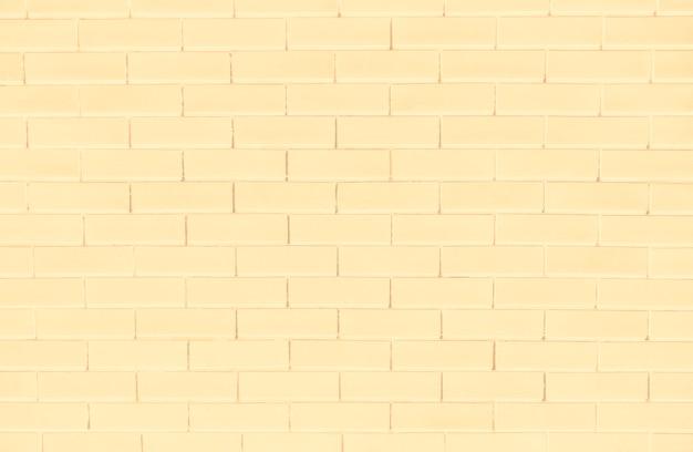 Mur de brique jaune fond texturé