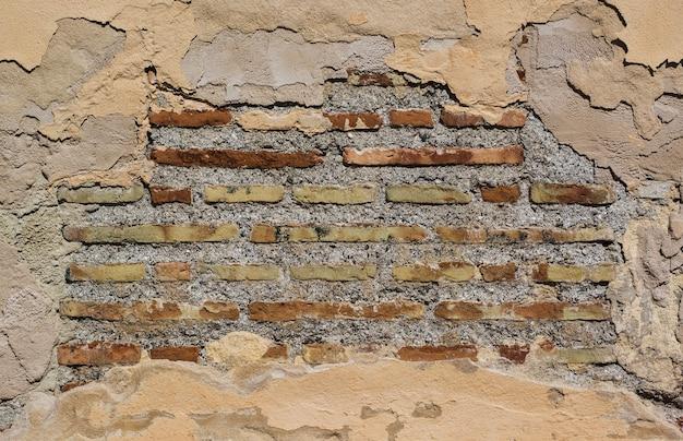 Mur de briques anciennes et résistant aux intempéries