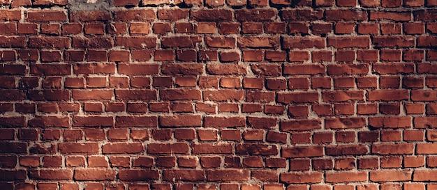 Mur de briques au soleil. fond de texture architecturale vintage