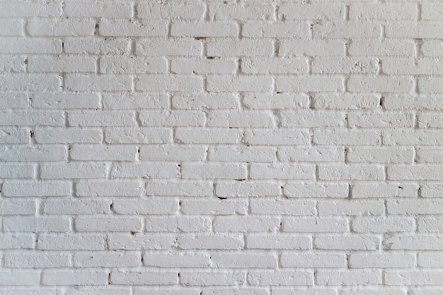 Mur de briques blanches dans la chambre minimale