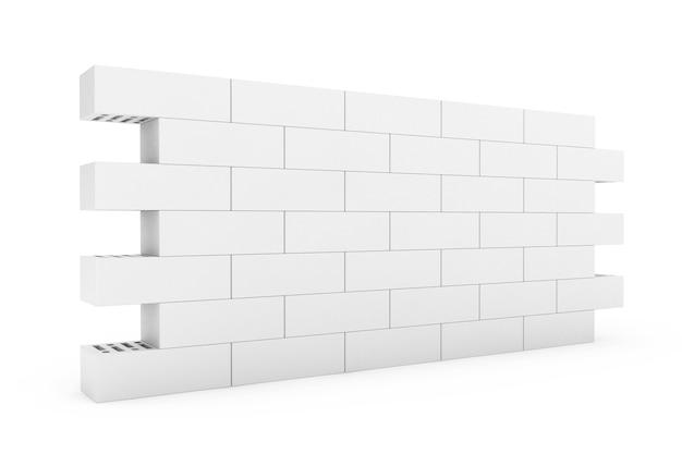 Mur de briques blanches sur fond blanc