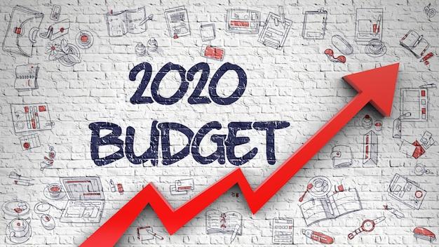 Mur de briques blanches avec inscription au budget 2020 et flèche rouge