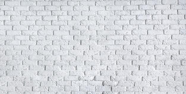 Mur de briques blanches maison intérieur fond propre texture vierge béton ciment modèle surface maçonnerie maçonnerie brique en-tête avec copie espace libre pour le texte
