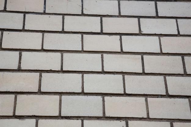 Mur de briques blanches, parfait comme arrière-plan, photographie carrée