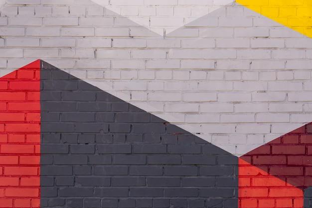 Mur de briques colorées grises, rouges, jaunes comme arrière-plan, texture.