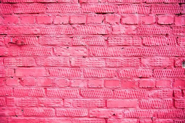 Mur de briques colorées peintes en rouge