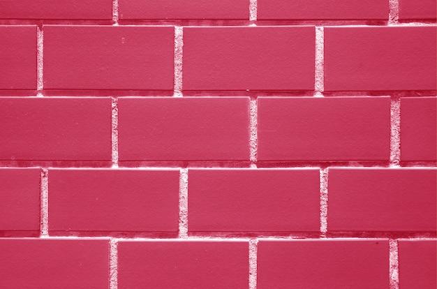 Mur de briques de couleur rose fuchsia et blanc