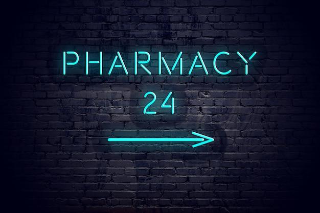 Mur de briques avec flèche au néon et pharmacie de signe 24.