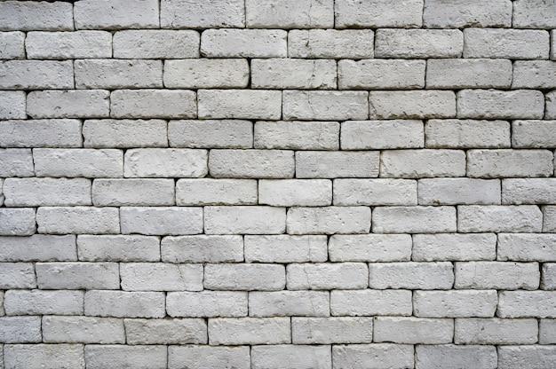 Mur de briques grises patiné