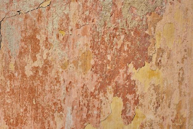 Mur de briques grungy avec texture de cadre en stuc cassé. vieux mur de briques