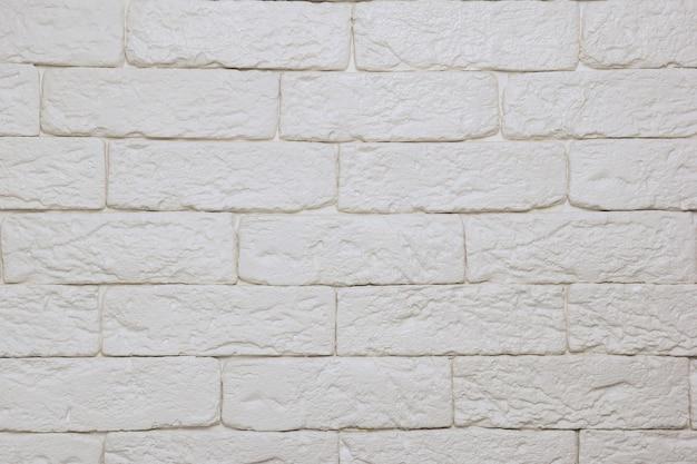 Mur de briques légères décoratives peintes vides sur tout le plan rapproché du cadre