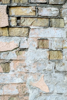 Mur de briques légères rayé. abstrait. en plein air. verticale.