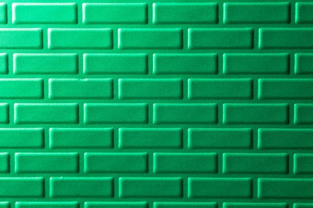 Mur de briques métalliques vertes