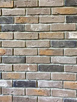 Mur de briques multicolores pour l'arrière-plan et l'espace de copie