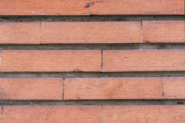 Mur de briques . mur de pierre de sable vieilli pour la texture et l'arrière-plan de conception.