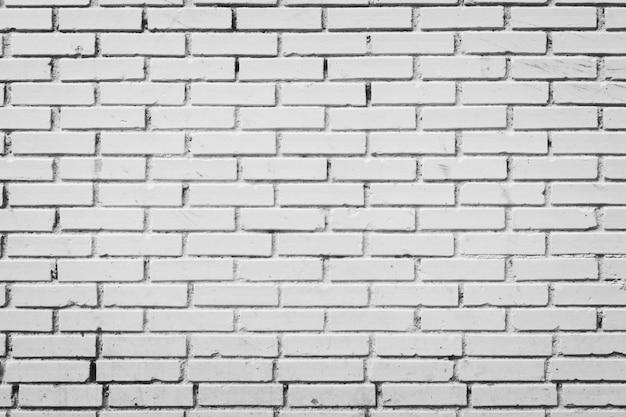 Mur de briques en noir et blanc traité
