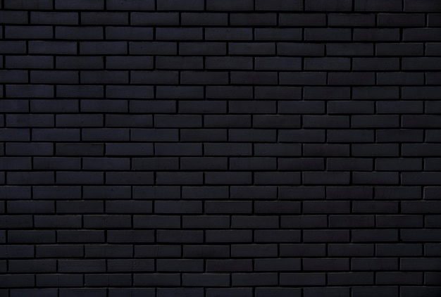Mur de briques noires pour le fond et la texture