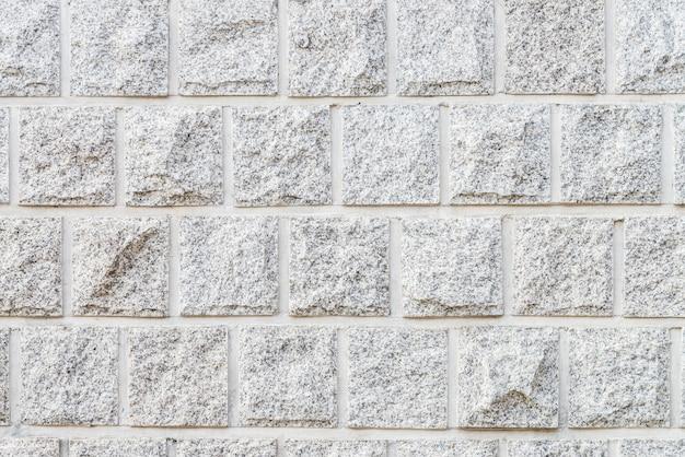 Mur de briques de pierre blanche