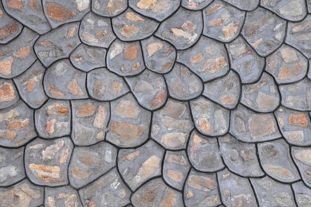 Mur de briques de pierre comme texture de fond.