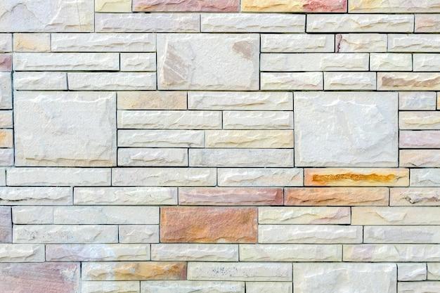Mur de briques en pierre pour le fond